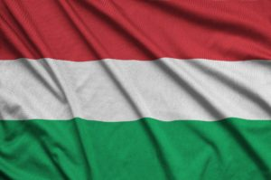 Hungary flag is depicted on a sports cloth fabric with many folds. Sport team waving banner