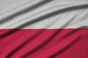 Poland flag is depicted on a sports cloth fabric with many folds. Sport team waving banner