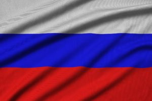 Russia flag is depicted on a sports cloth fabric with many folds. Sport team waving banner